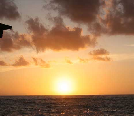 sunset over the ocean with horizon at bottom