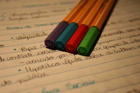 Colored pens on a notebook