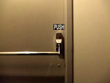 door with push bar and sign