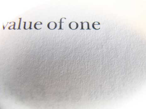 Value of one printed on textured paper