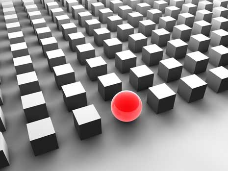 One red sphere in a sea of gray cubes