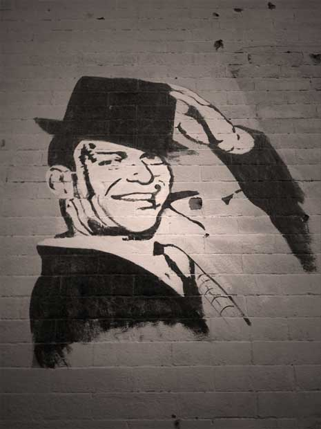 Frank Sinatra painted on a brick wall