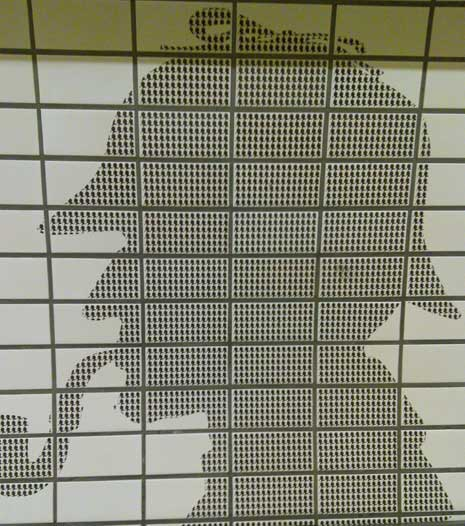 Sherlock Holmes silouhette on wall of Baker St tube station