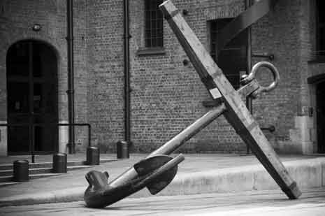 Black and white photograph of an anchor in the street