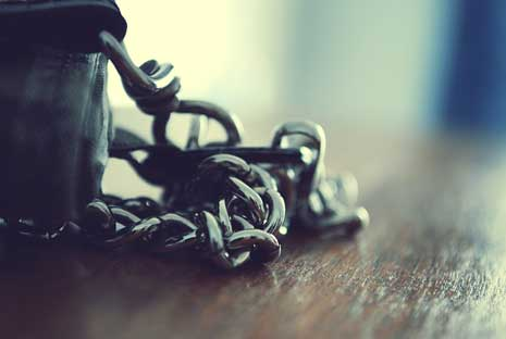 Chain and wallet resting on table