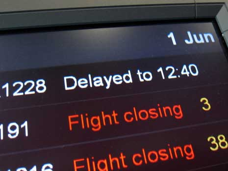 Airport display showing flight delays
