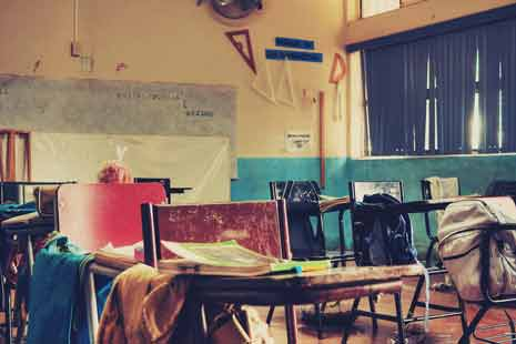 Desks and chairs in an empty classroom