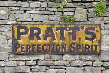 Sign for Pratt's Perfection Spirit at the Swanage Railway