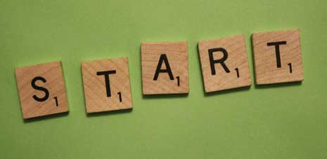 Start spelled out in Scrabble tiles