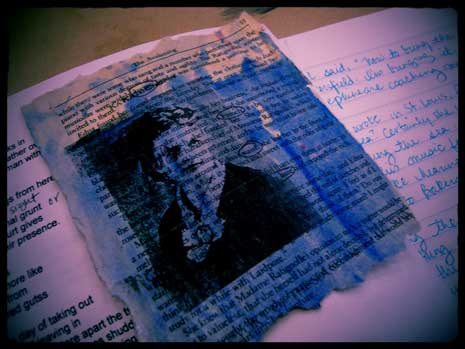 Collage of notebook, image and, newspaper stained with ink