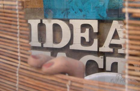 Window blinds opened to reveal the word 'Idea' inside