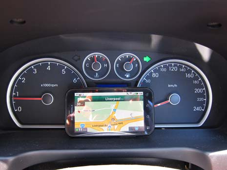 Google maps loaded on a phone sitting on a car dashboard to provide navigation