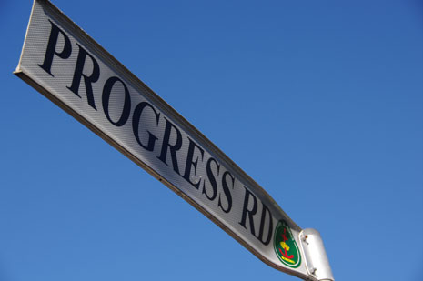 Progress Road street sign against a blue background