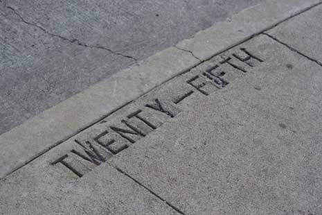 'Twenty-Fifth' carved into the sidewalk