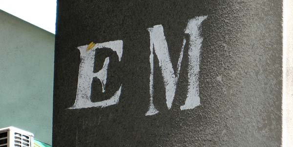 The letters EM painted on a concrete wall