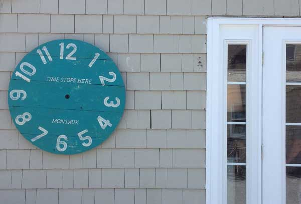 Handless clock at Gosman's Dock that says 'time stops here'