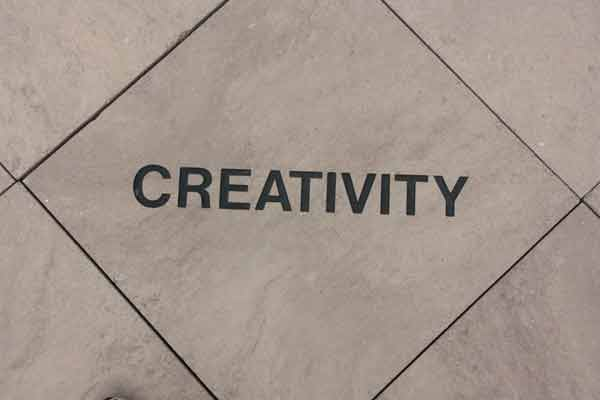 Creativity carved in a stone tile