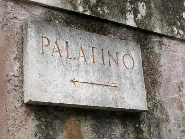 Stone sign with 'Palatino' carved into it