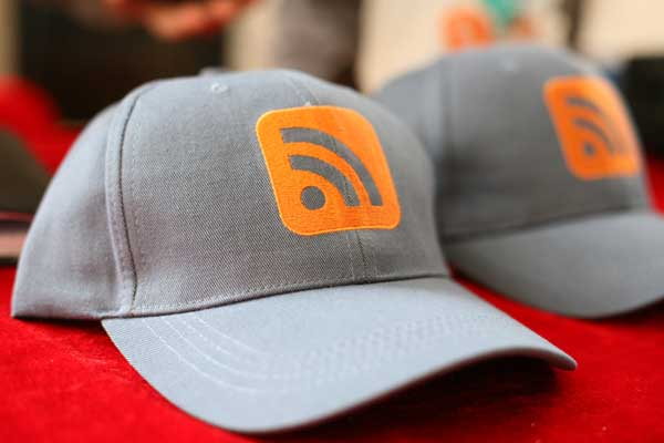 RSS logo on a pair of baseball caps