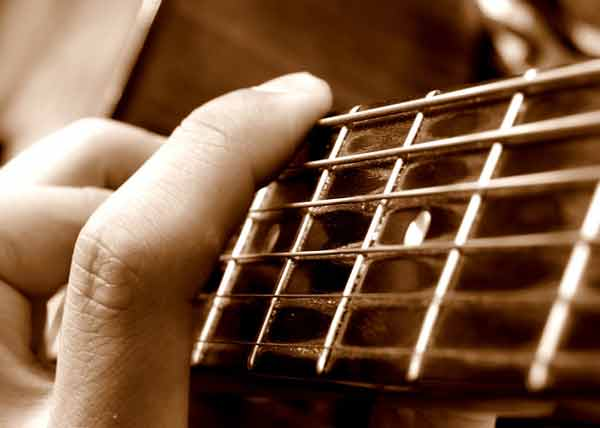 Fingers on a guitar fretboard
