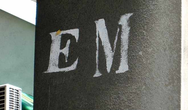 E and M painted on a wall