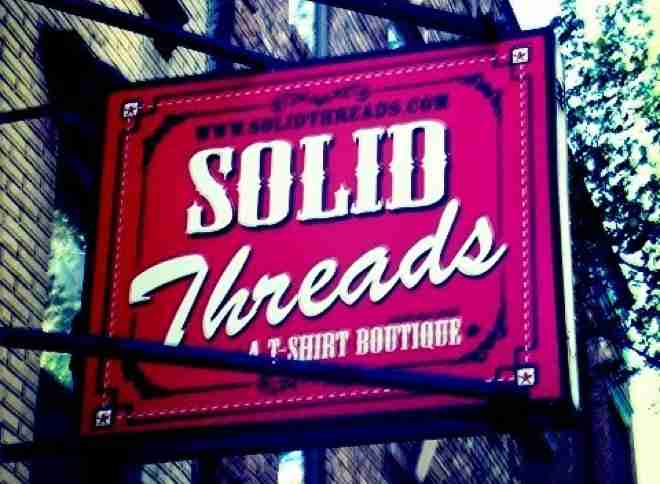 Sign for Solid Threads: A T-Shirt Boutique
