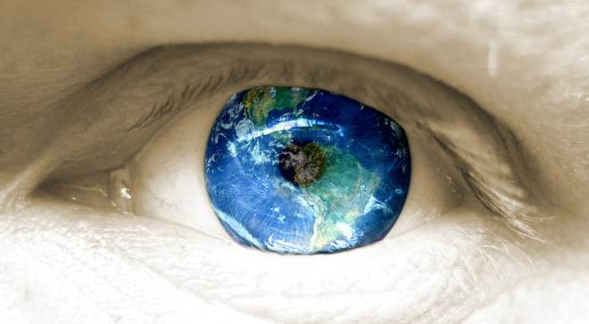 An eye reflecting the world
