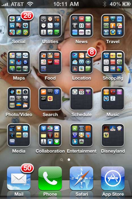 iPhone home screen with folders of apps