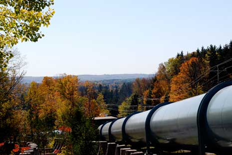 Pipeline among autumn trees at trenton falls