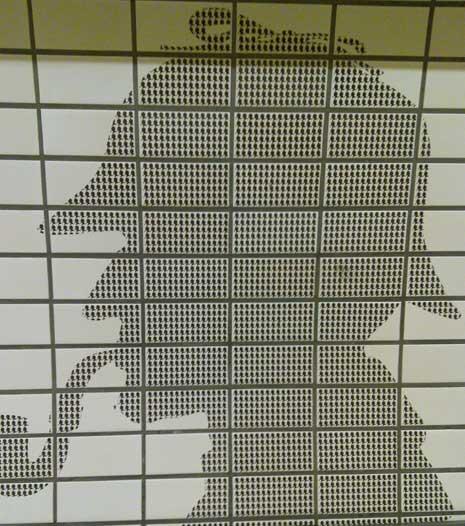Sherlock Holmes silouhette on wall of Baker St tube station