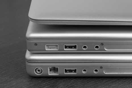 MacBook Air on top of MacBook Pro on top of Powerbook G4