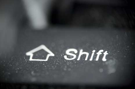 Closeup of an arrow pointing up and the word shift
