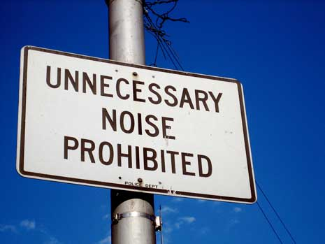 Street sign reading: Unnecessary Noise Prohibited