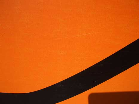 Abstract photograph from a detailed closeup of a traffic sign and its shadow