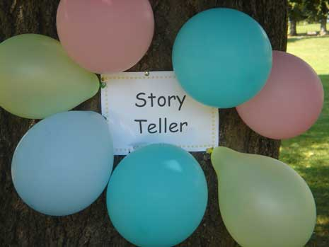 Story teller sign surrounded by balloons