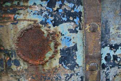 Rusted metal and chipped paint showing texture