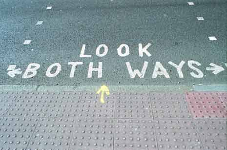 Look both ways written in chalk on the pavement