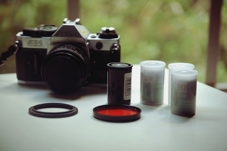 Camera and film canisters