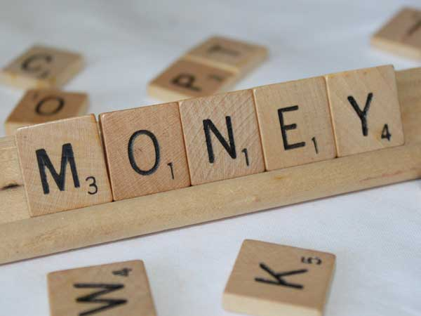 Money spelled out in Scrable tiles