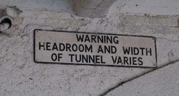 Broad Street Tunnel: Sign reading Warning Headroom and Width of Tunnel Varies