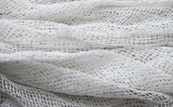 a flexible mesh net folded over onto itself