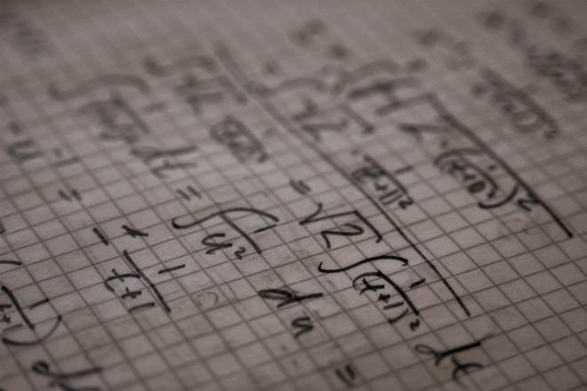 Mathematical equations on graph paper