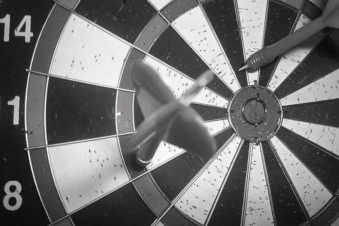 Darts stuck in a dartboard