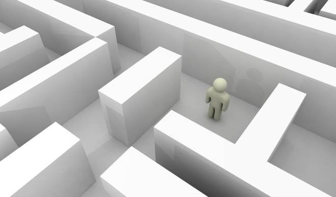 A figure in a maze deciding which way to proceed